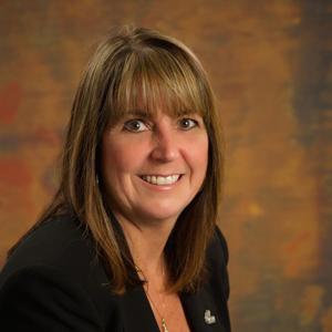 headshot of female Educational Foundation Board member Carol Curtis