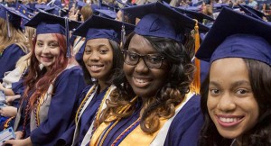 close up photo of 4 smiling women - graduation